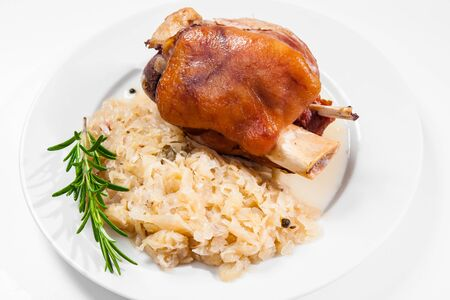 knuckle: Schweinshaxe (German Pork Knuckle) with pickled cabbage Stock Photo