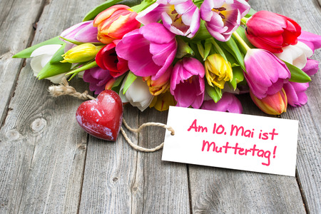 Tulips with tag and german text for mothers day photo