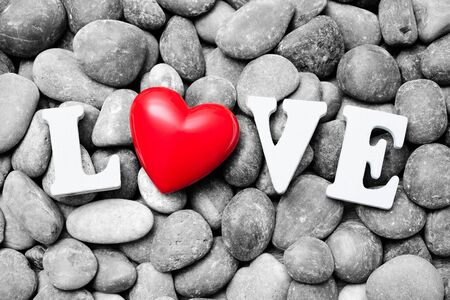 red pebble: The word Love with red heart on pebble stones. Valentine�s Day background Stock Photo