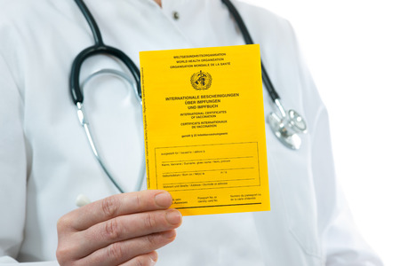 Doctor showing an international certificate of the vaccination Archivio Fotografico
