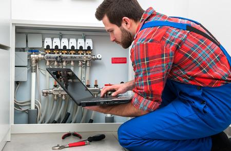 Technician servicing the underfloor heating Stock Photo - 37536869
