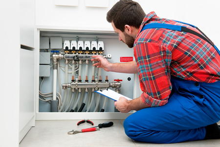 plumbing: Technician servicing the underfloor heating