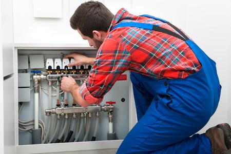 Technician servicing the underfloor heating photo