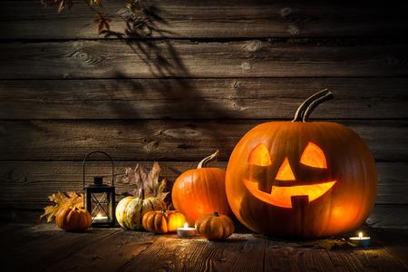 Halloween pumpkin head jack lantern on wooden background Banco de Imagens