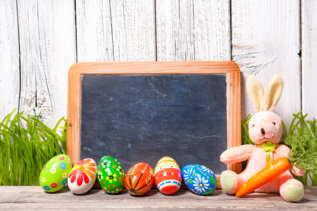 Easter decoration with sugar rabbits, eggs and message board photo