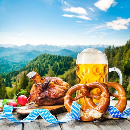 grilled pork: Roasted pork knuckle with pretzels and beer. Oktoberfest german festival background