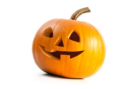 Funny carved Halloween pumpkin isolated on white background