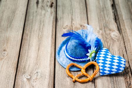 Background with Bavarian hat, pretzel and a heart, Oktoberfest