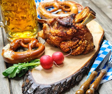 Roasted pork knuckle with pretzels and beer. Oktoberfest photo