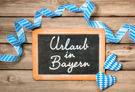 welcome party: Board with German text Holidays in Bavaria Stock Photo