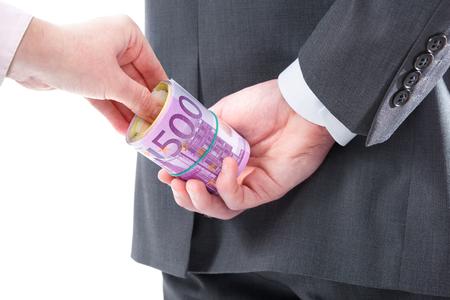 venal: Concept - corruption. Businessman in a suit takes a bribe
