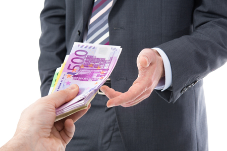 venality: Concept - corruption. Businessman in a suit takes a bribe