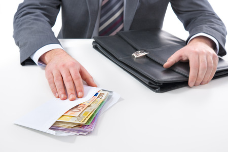 money notes: Concept - corruption. Businessman in a suit takes a bribe