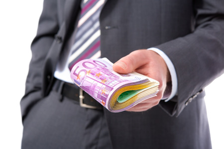 venality: Businessman holding many euros banknotes