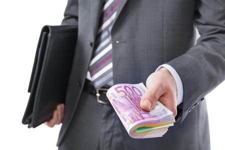 venality: Businessman holding many euros banknotes