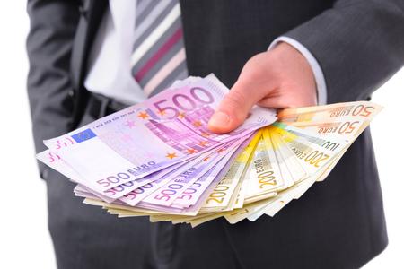 venal: Businessman holding many euros banknotes