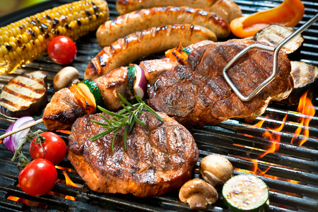 meat on grill: Assorted delicious grilled meat with vegetable over the coals on a barbecue