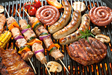 grill chicken: Assorted delicious grilled meat with vegetable over the coals on a barbecue