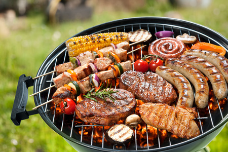 frankfurters: Assorted delicious grilled meat with vegetable over the coals on a barbecue