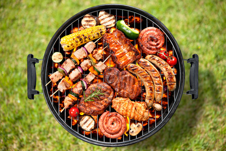 Assorted delicious grilled meat with vegetable over the coals on a barbecue Stok Fotoğraf - 39490659