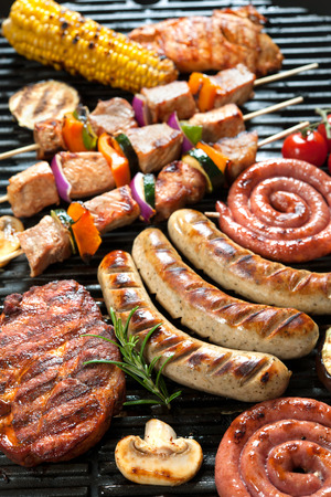 barbecue: Assorted delicious grilled meat with vegetable over the coals on a barbecue