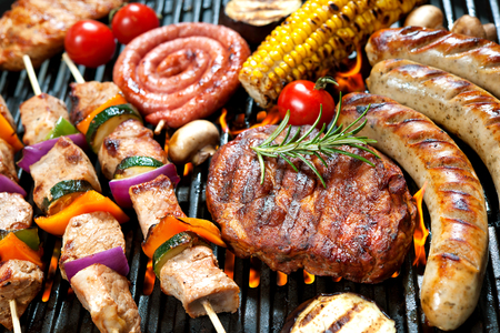 barbecue pork barbecue: Assorted delicious grilled meat with vegetable over the coals on a barbecue