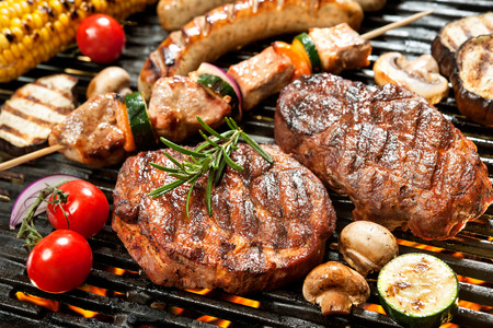 Assorted delicious grilled meat with vegetable over the coals on a barbecue Stok Fotoğraf - 40230576