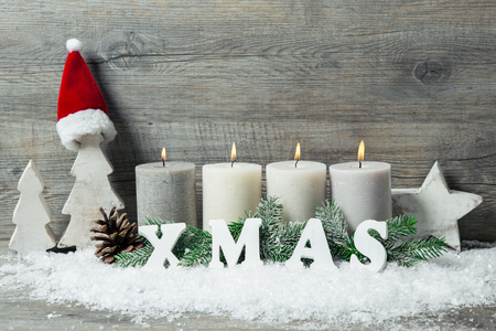 advent candles: Rustic Christmas background with four advent candles burning