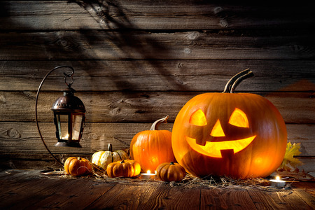 Halloween pumpkin head jack lantern on wooden background Foto de archivo