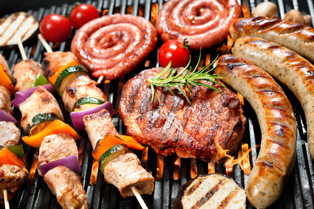 frankfurter: Assorted delicious grilled meat with vegetable over the coals on a barbecue