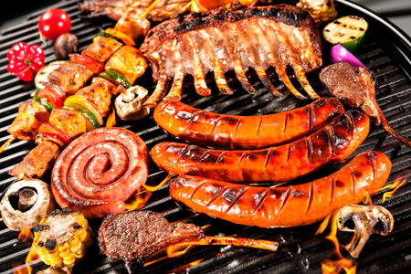coals: Assorted delicious grilled meat with vegetable over the coals on a barbecue