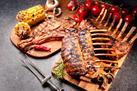 dinner plate: Grilled Rack of lamb on a cutting board