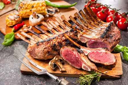 rack of lamb: Grilled Rack of lamb on a cutting board