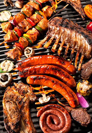 skewer: Assorted delicious grilled meat with vegetable over the coals on a barbecue