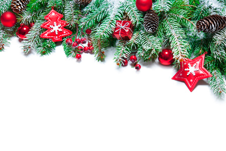 Fir tree branches with christmas decoration isolated on white background Stock Photo