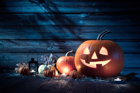 Halloween pumpkin head jack lantern on wooden background Stockfoto