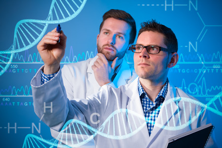 medical professional: Group of geneticists working at media screen. Genetic engineering Stock Photo