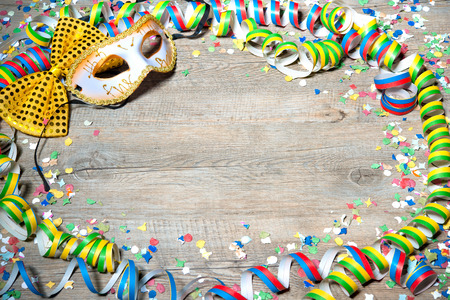 surprise party: Colorful carnival background with garlands, streamer, party hats, confetti and mask