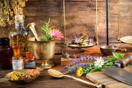 homeopathic: Ancient natural medicine, herbal, vials and scale on wooden background