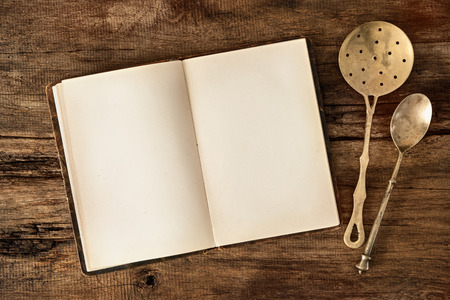 Empty menu or cookbook and vintage kitchen utensils on wooden table Stok Fotoğraf
