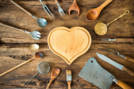 writing utensil: Vintage kitchen utensils on wooden table