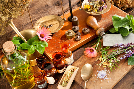 pharmacy equipment: Ancient natural medicine, herbal, vials and scale on wooden background