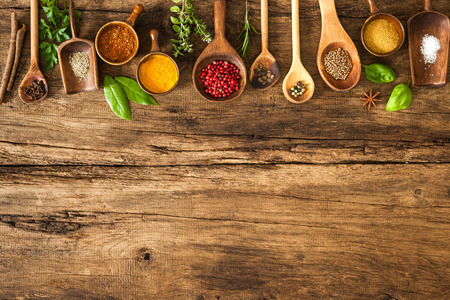 food additives: Various colorful spices on wooden table