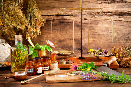 botanical medicine: Ancient natural medicine, herbal, vials and scale on wooden background