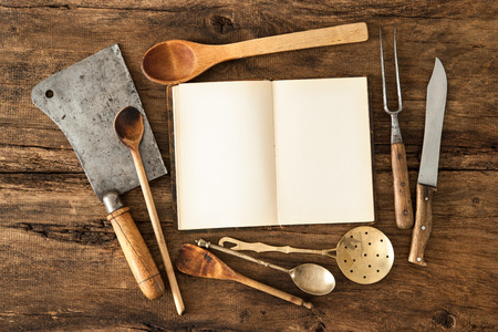 food preparation: Empty notebook or cookbook and vintage kitchen utensils on wooden table