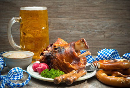 knuckle: Roasted pork knuckle with pretzels and beer. Oktoberfest Stock Photo