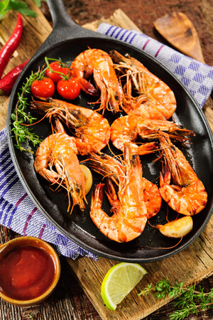 antipasto: Fried king prawns on iron pan Stock Photo