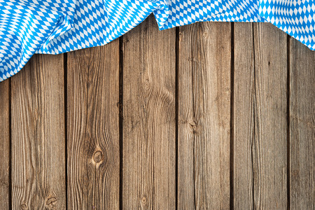 Rustic background for Oktoberfest with bavarian white and blue fabric