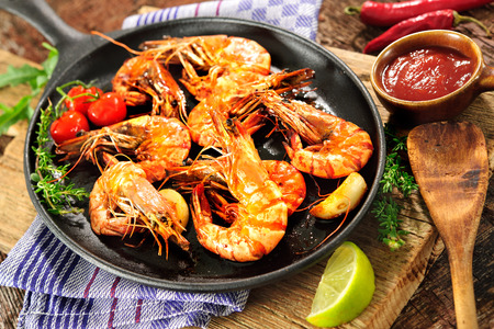 Fried king prawns on iron pan Stock Photo