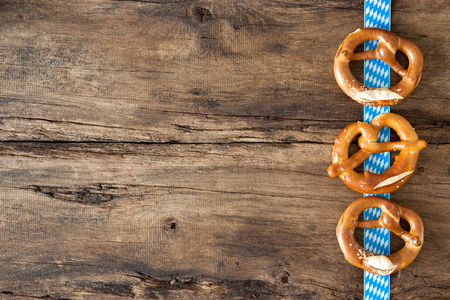 Bavarian pretzels on old wooden background for Oktoberfest